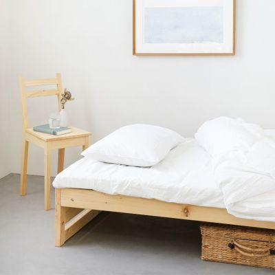 軽やかな印象を与えるベッドルーム<br>ベッドM フラット / Eチェア